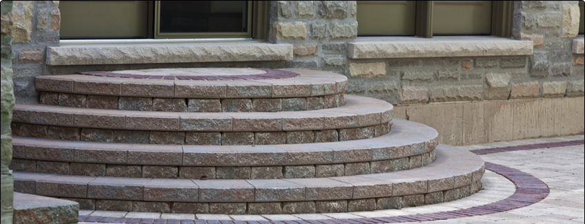 outdoor stone fireplace and interlocking patio